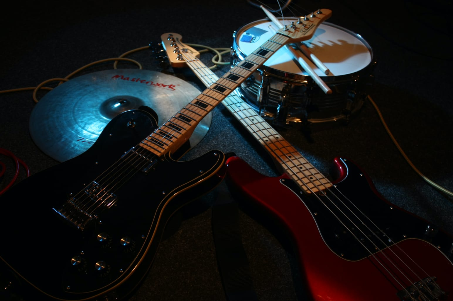 Separated Minds instruments guitar bass drums sticks cables cymbal lying on the ground full size for background optimized for web